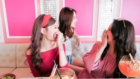 women chatting in restaurant