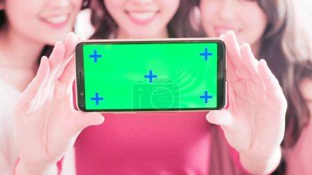 young girls  showing  screen