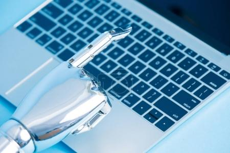 robot hand using laptop
