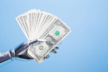 robot hand take us dollar
