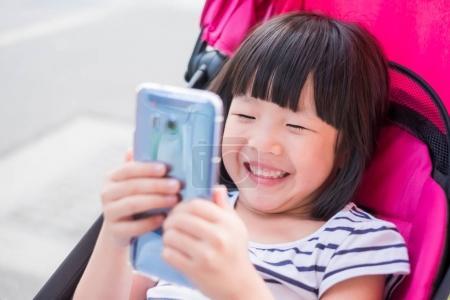 cute little  girl  using  phone