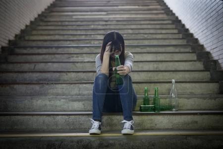 depressed woman feeling  upset with alcoholism  in underground