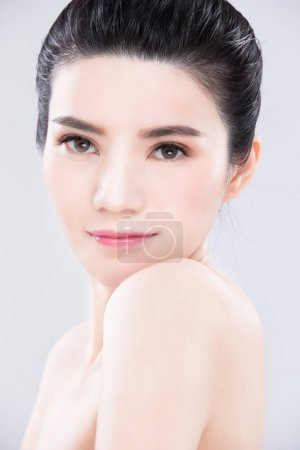 young woman posing.  beauty skin care concept on the gray background