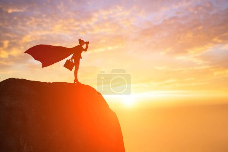 silhouette of super business woman with  binoculars on mountain