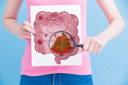 woman with  unhealthy  intestine billboard and magnifying on the blue background