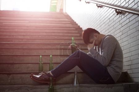 Photo for Depressed man feeling  upset with alcoholism problem - Royalty Free Image