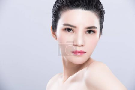 woman posing. beauty skin care concept on the gray background