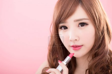 beauty woman with lipstick on the pink background