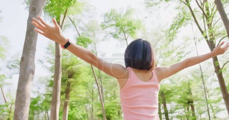 woman feeling  free and enjoying  in the forest