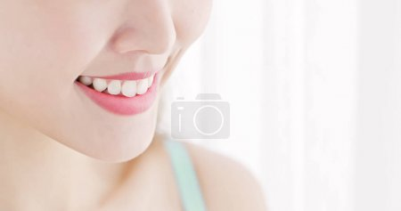close up of beauty asian  woman with white  teeth