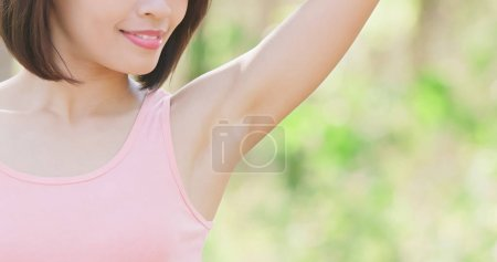 woman, underarm hair removal concept with green background