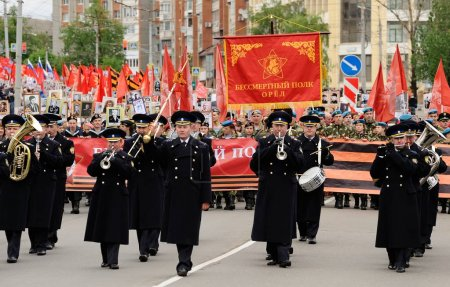 Orel, Russia - May 9, 2017: Victory Day selebration. Military orchestra marching in front of Immortal regiment
