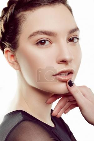 Beautiful Young Woman with Clean Fresh Skin touches own face. Girl beauty face care. Facial treatment. Cosmetology, beauty and spa.