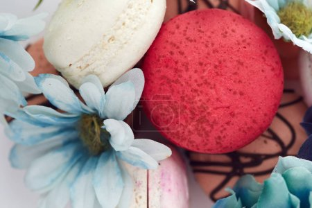 Photo for Colorful pastel macaroons with spring flowers - Royalty Free Image