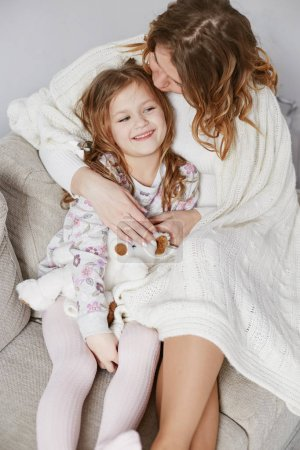 Photo for Mother and daughter enjoying time together at home. - Royalty Free Image