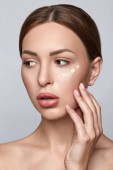 Woman applying foundation. Skin tone cream on woman face. Beautiful woman portrait beauty skin healthy and perfect makeup.