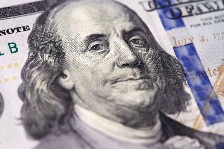 Benjamin Franklin close-up portrait on dollar banknote.