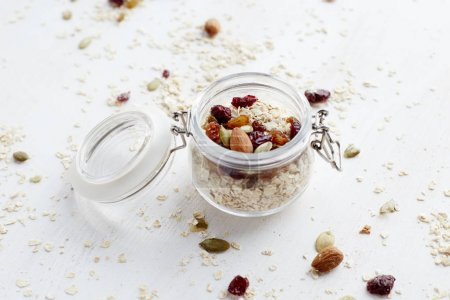 Photo for Oatmeal with nuts and berries in jar. Healthy organic superfood. - Royalty Free Image