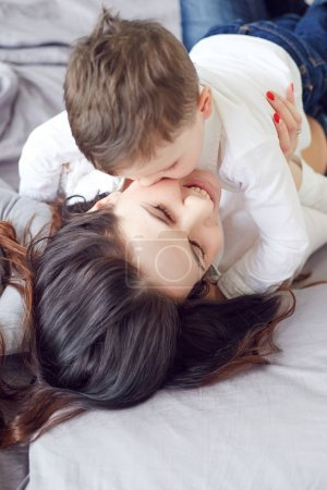Son kissing his mother. Maternity concept. Parenthood. Motherhood