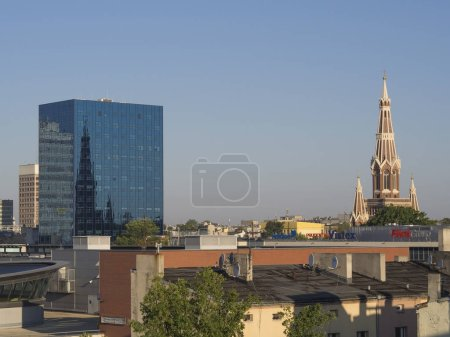 Poland, Lodz, August 30, 2017:view on Lodz city center with skyscraper and old red brick cathe
