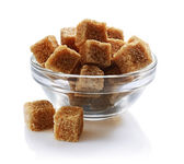 Brown cane sugar cubes in glass bowl