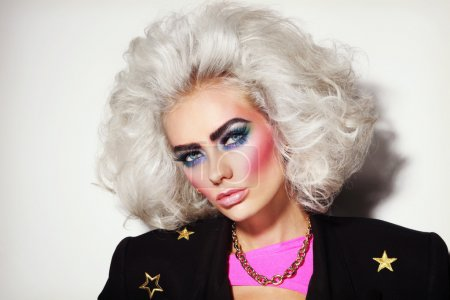 Young platinum blond woman with 80s makeup