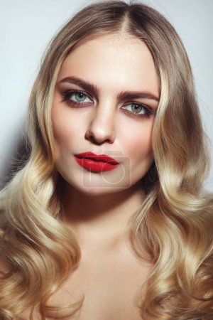 Glamorous woman with red lipstick