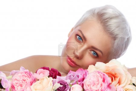 Young beautiful woman with fresh flowers
