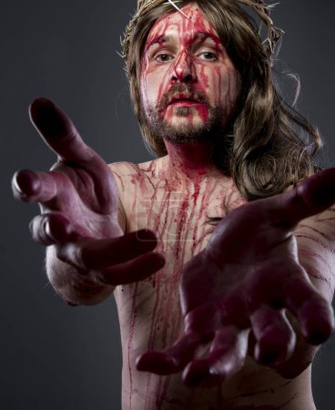 jesus with the crown of thorns and blood on his body