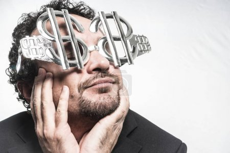 Businessman with dollar-shaped glasses
