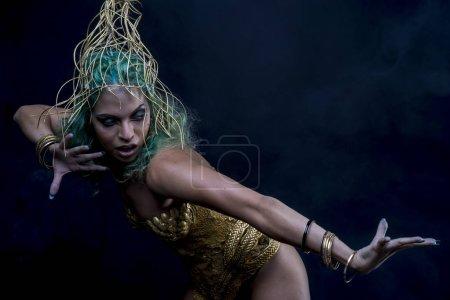 woman in golden goddes armor