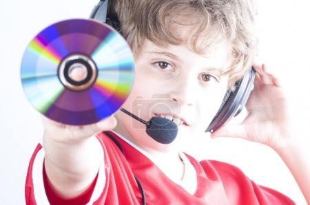boy with headphones holding dick