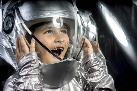 Boy playing to be an astronaut