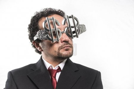 Businessman wearing glasses with dollar signs
