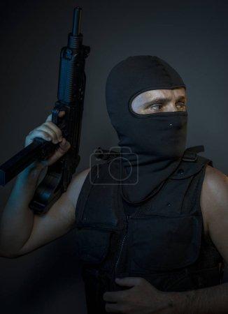 terrorist in bulletproof vest and balaclava