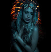ethnic, beautiful girl with plume of american indian feathers