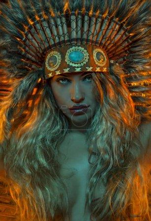 Spirituality, beautiful girl with plume of american indian feathers