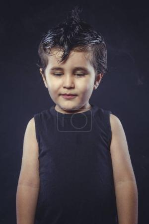 smile, boy with hair gum in rocker dress with funny and expressive faces