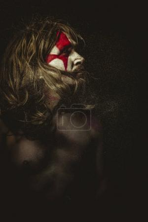 Tribe, Wild warrior with metal sword and war paintings on the face, long hair