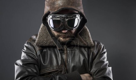 Army, recreation of the Second World War, old airplane pilot with brown leather jacket, cap of avidor and large glasses