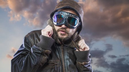 pilot of the 20s with sunglasses and vintage aviator helmet. Wears leather jacket, beard and expressive faces