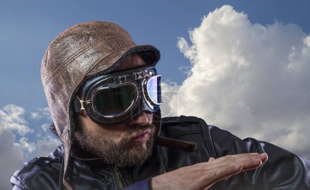Explore pilot of the 20s with sunglasses and vintage aviator helmet. Wears leather jacket, beard and expressive faces
