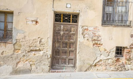 Street, medieval door Spanish city of Segovia. Old wooden entrance. ancient architecture