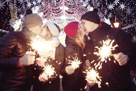 youth celebrating New Year on street