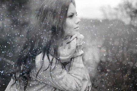 Photo for Winter portrait of young girl with snowflakes in the air - Royalty Free Image