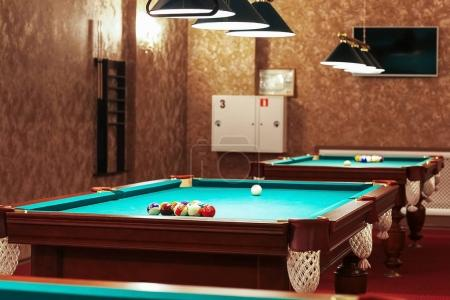 Large room with pool tables