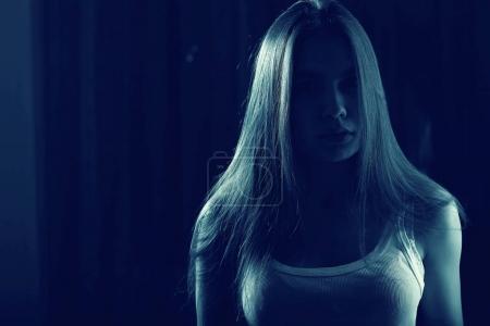teenage girl in white tank top