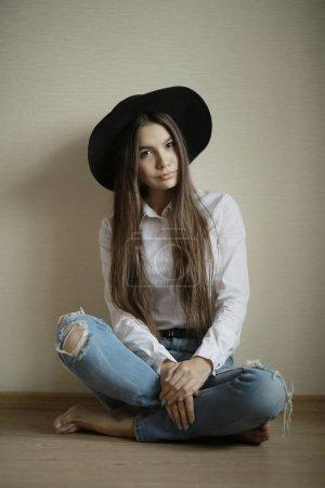 teenage girl in black hat