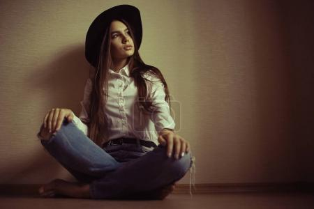 teenage girl in black hat