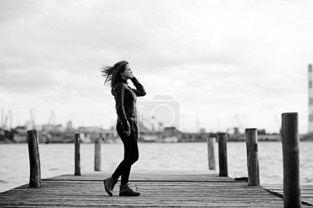 young beautiful woman at pier